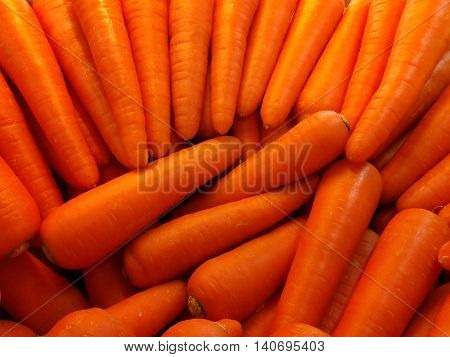 carrot's is seen at food market.( Low light, selective focus, blurr background, close up)