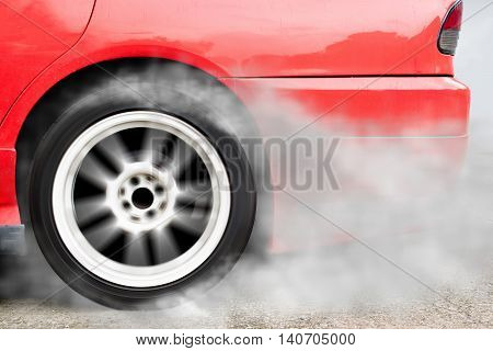 red car wheel drifting and smoking on track dark edition