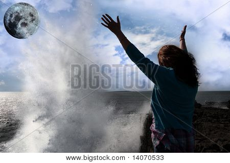 Lone Woman With Raised Hands Facing A Wave And Full Moon On Cliff Edge