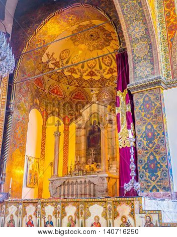 VAGHARSHAPAT ARMENIA - MAY 30 2016: The richly decorated altar in Etchmiadzin Cathedral on May 30 in Vagharshapat.
