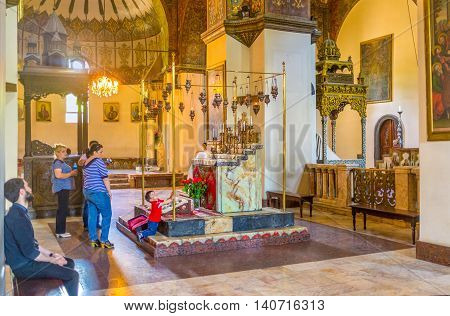 VAGHARSHAPAT ARMENIA - MAY 30 2016: The interior of Etchmiadzin Cathedral with the Altar of Descent in the middle on May 30 in Vagharshapat.