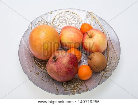mix fresh fruits on plate isolated on white