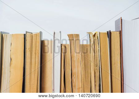 A stack of books in hard and soft cover.