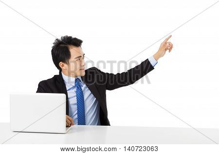 young Business man pointing to copy space