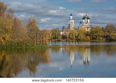 autumn landscape with views of the ancient Orthodox Church, which stands on the banks of the Oka river