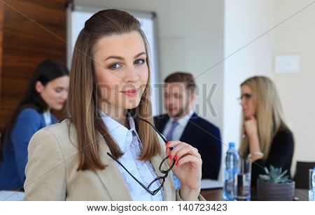 business woman with her staff people group in background at modern bright office indoors