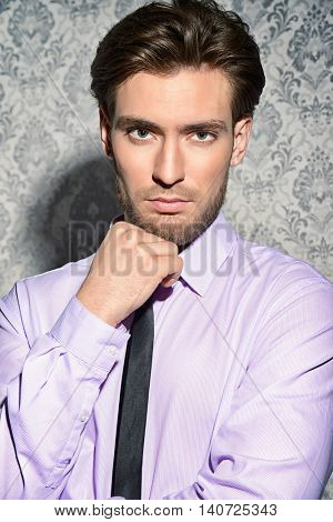Handsome respectable middle-aged man in white shirt and a tie. Men's beauty, fashion. Business style.