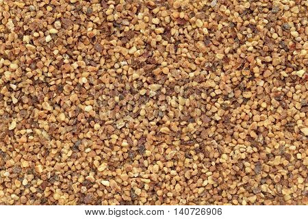 Organic Nutmeg (Myristica fragrans) in tea cut size. Macro close up background texture. Top view.