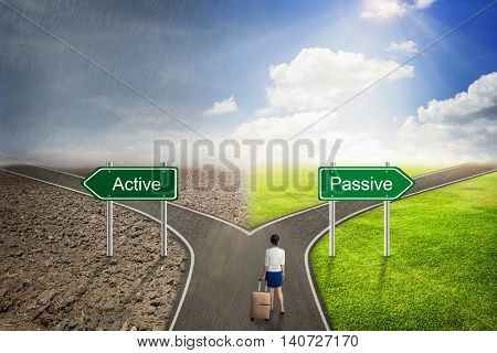 Businesswoman concept, Road Sign Active or Passive choose the correct way.