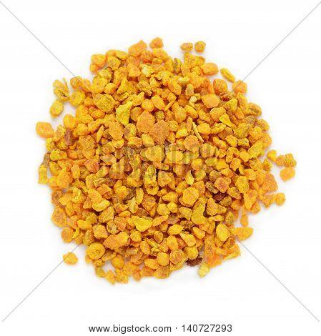 Organic Turmeric or Haldi (Curcuma longa) in tea cut size isolated on white background. Macro close up. Top view.