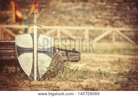 photo of the old sword and shield on the castle background