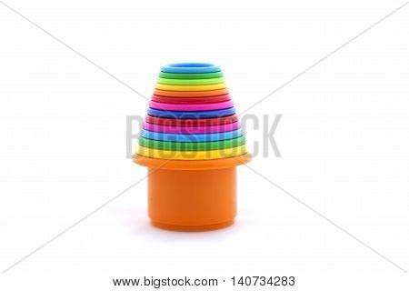 Toy colorful pyramidion on a white background