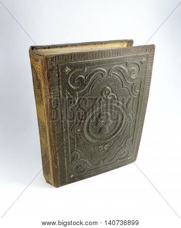 Antique book with decorative cover. Old book, studio shot.