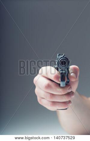 Weapon gun. Man's hand holding a gun. 9 mm pistol.