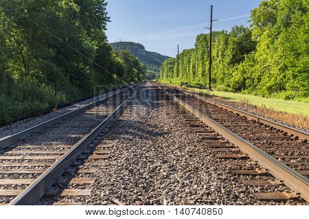 A railroad double track mainline leading off to the distance.