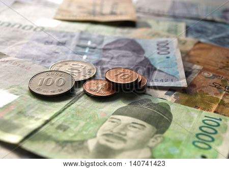 Korean won coin on banknote asian currency business finance concept
