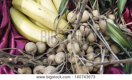 Longan Fresh (Dimocarpus longan.)A bunch of Longan and Fresh organic Banana