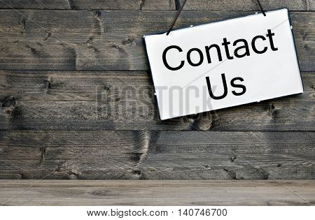 Contact Us message on wooden table