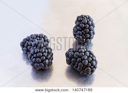 fresh black-berry berry isolated on silver background.
