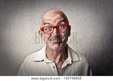 Smiling man wearing red glasses
