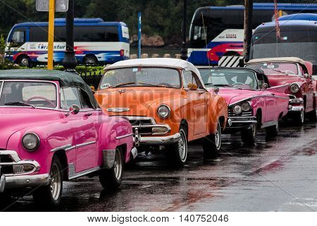 HAVANA, CUBA, 23.01.2016 American Vintage Cars under the rain. Typical Cuban Taxi