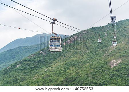 HONG KONG - MAY 26: The Ngong Ping 360 cable cars carry tourists to Ngong Ping village in the cloudy day on May 26 2016 in Hong Kong.