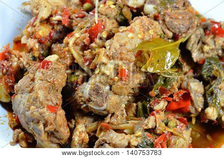spicy stir-fried pork rib and chicken with lemon leaf