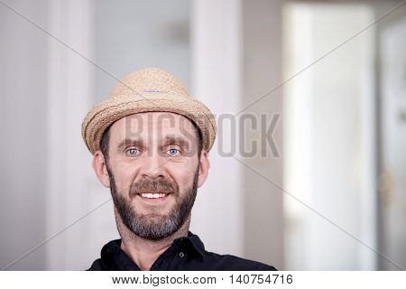 Portrait Of Friendly Looking Hipster With Stray Hat