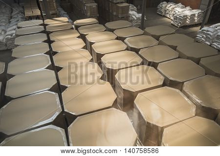 Rows of shelves with boxes in microbrewery