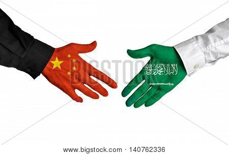 China and Saudi Arabia leaders shaking hands on a deal agreement