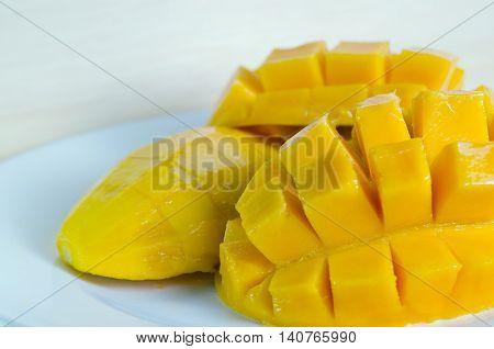 Mango Nicely Cut On Wooden Background (also Known As Horse Mango, Mangifera Foetida, Anacardiaceae,