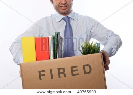Sad fired businessman leaves his office on white background