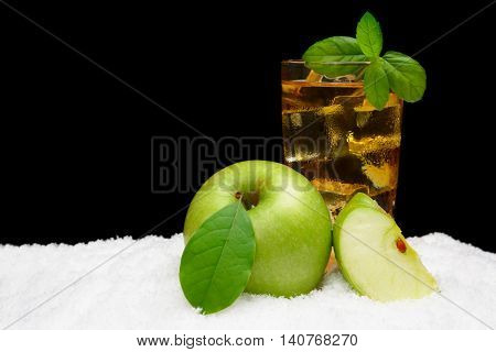 Frosty Apple Juice,ice Cubes And Apple With Leaves On Black On Snow
