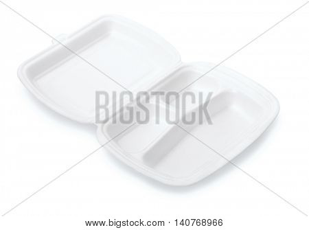 Small triple compartment foam take out food container isolated on white