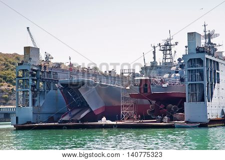 Floating dry dock with two Russian landing crafts under repair inside.