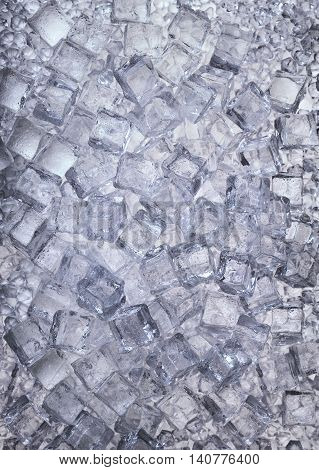 Set of ice cubes and crushed ice as background.