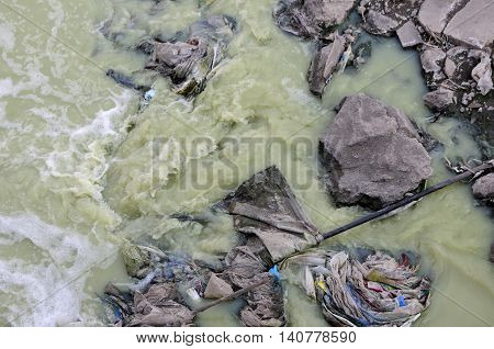 A water canal and run off area within Zhaodong China filled with trash creating polluted water in Heilongjiang province.