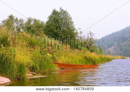 Fishing Rowboat Iron Red In The Green Grass