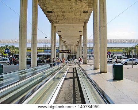 Palma de Majorca Spain - June 25 2008: Airport Palma roofed man conveyor towards main entrance sign showing way to terminal
