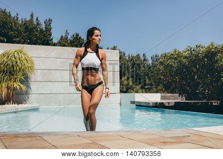 Attractive Woman Walking Out Of Swimming Pool