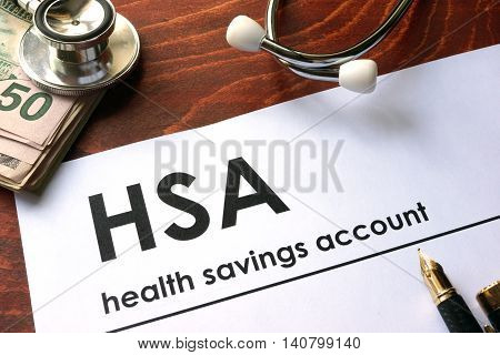 Paper with words weekly health savings account (HSA) on a table.
