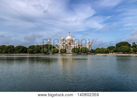 Beautiful Victoria Memorial with adjoining lake and lovely blue sky