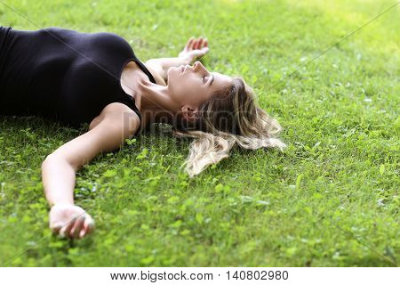 Lovely woman lying on the grass
