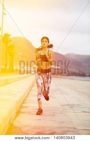 Young Brunette Running With Her Earphones