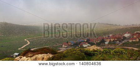 Low Clouds Over A Mountain Village