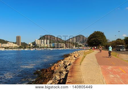 RIO DE JANEIRO - August 9: People running and riding bikes on bycicle path near Botafogo beach on August 9 2015 in Rio de Janeiro.