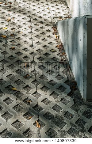 A repeating diamond pattern is created by cement inlays.