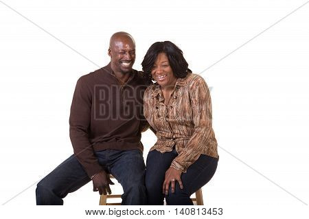 Middle aged man and woman standing close isolated on white