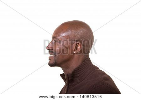 Side profile of a bald middle aged man isolated on white
