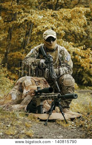 Sniper and spotter of Green Berets US Army Special Forces Group in action